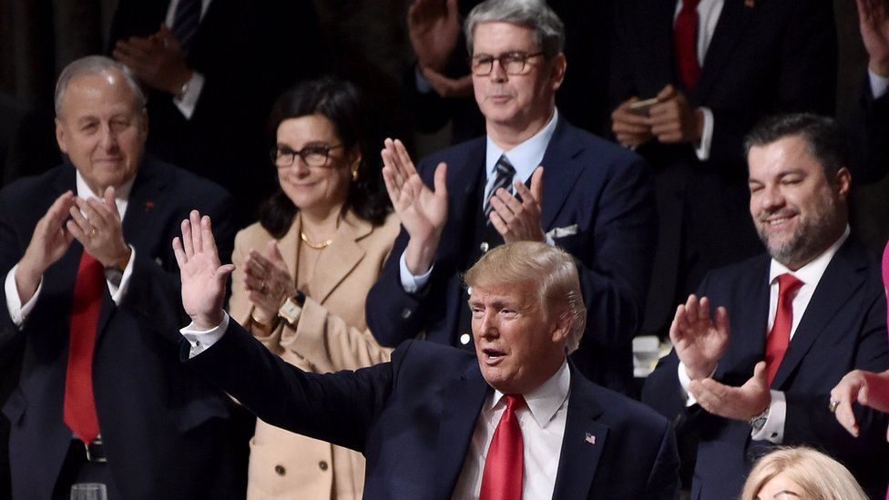 Donald Trump is greeted warmly at the Economic Club of New York