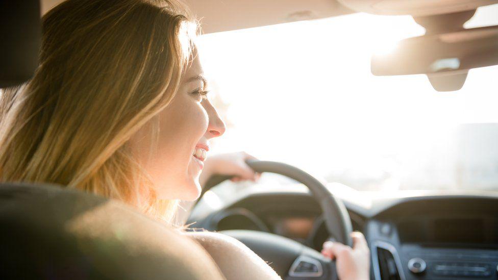 Teenager driving car