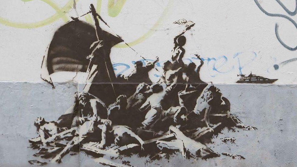 Banksy painted another piece in Calais showing refugees waving to a luxury yacht