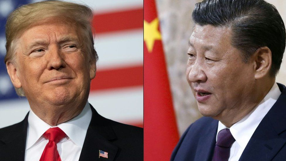 This combination of pictures created on May 14, 2020 shows recent portraits of China's President Xi Jinping (R) and US President Donald Trump.