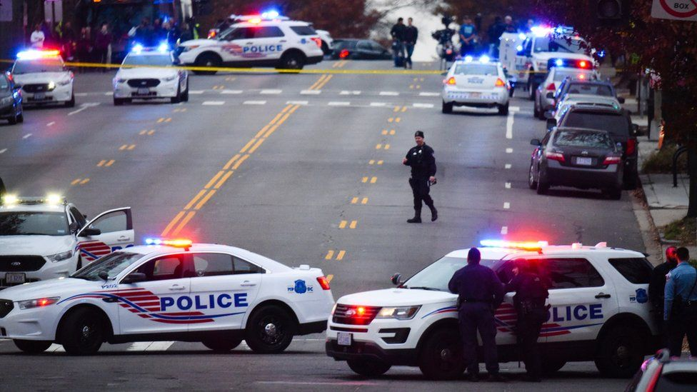 Police secure the scene near Comet Ping Pong in Washington, Sunday, Dec. 4, 2016.