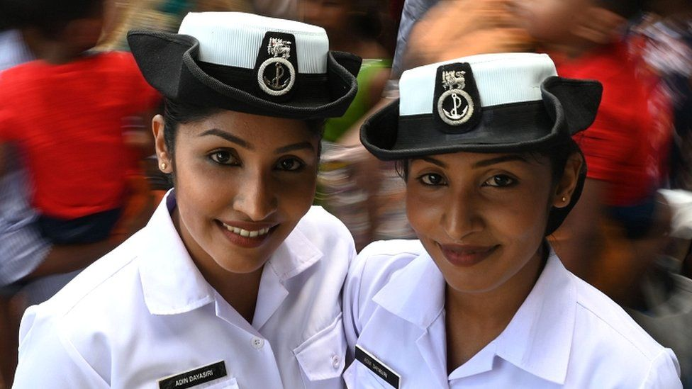 Navy volunteer twins pose for a picture at the gathering