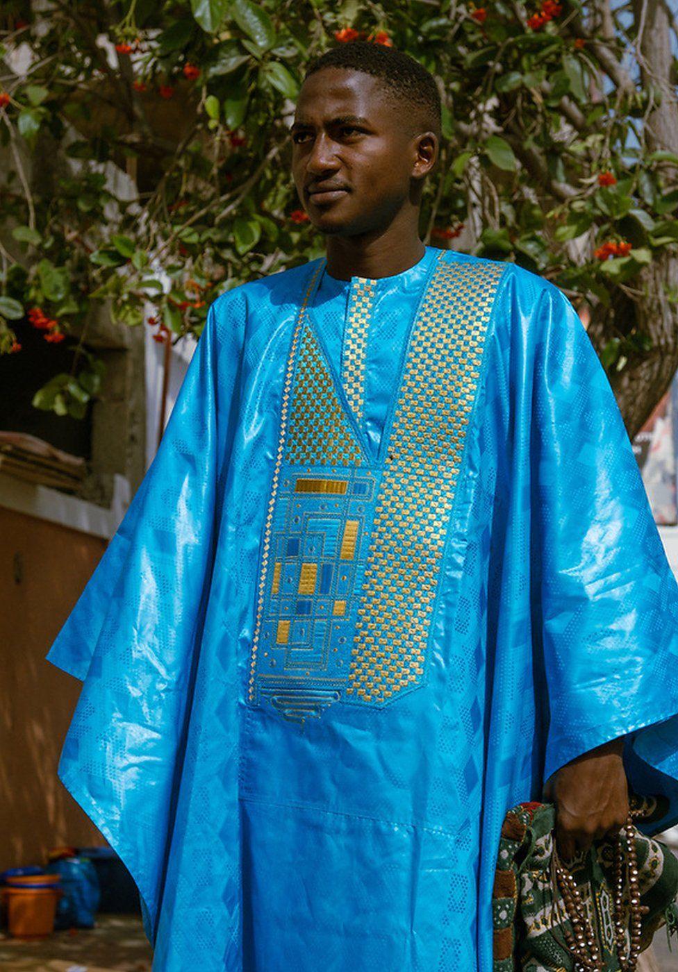 Boubacar Diallo wears a blue boubou