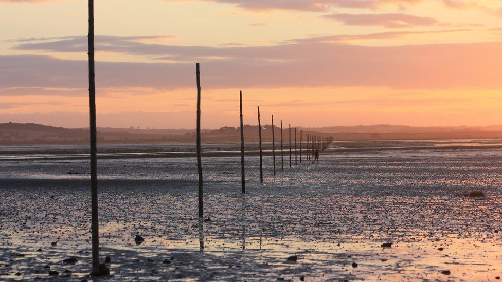 A solitary figure on the Holy Island of Lindisfarne