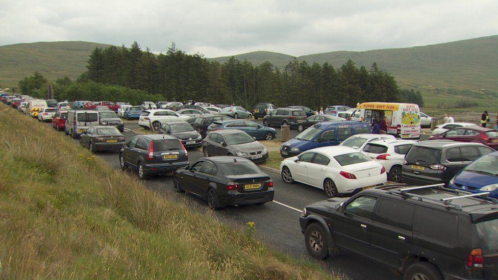 Dozens of cars at Spelga Reservoir