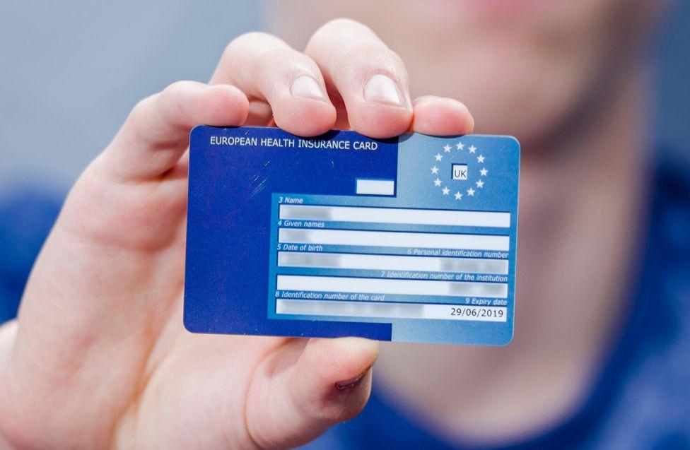 Hand holding a European Health Insurance Card