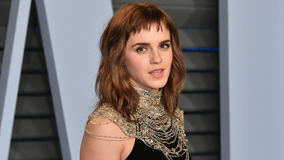 Emma Watson posing for photographs on her way to the Vanity Fair Oscar Party