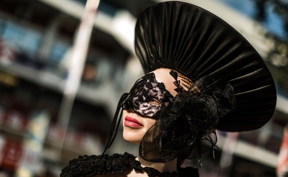 An albino model in a black hat the Durban July race event, Durban , South Africa - Friday 6 July 2018