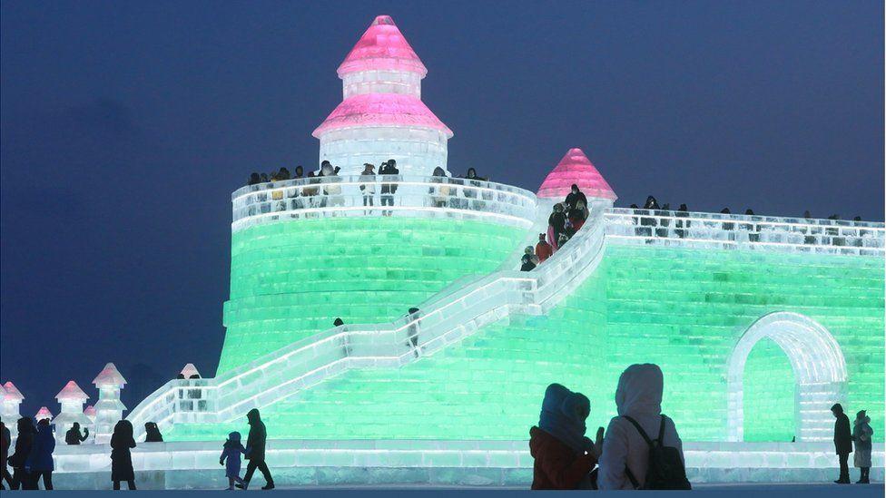 An illuminated ice tower