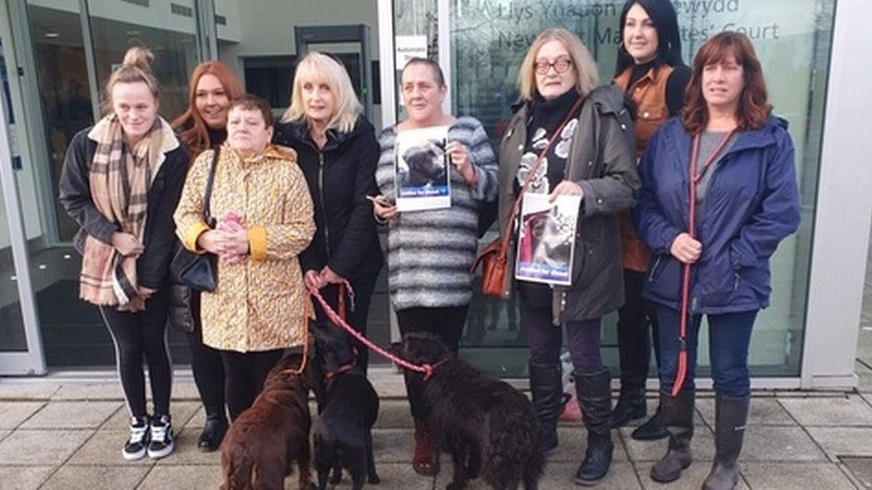 Protestors outside Newport Magistrates Court with dogs and posters of Diesel