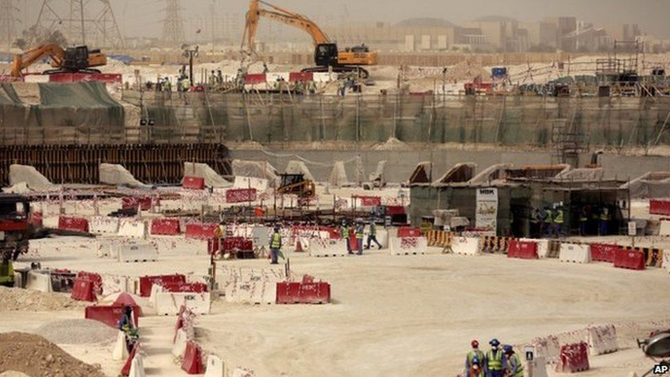 In this photo taken during a government organised media tour, labourers work at the Al-Wakra Stadium that is under construction for the 2022 World Cup, in Doha, Qatar, Monday, May 4, 2015
