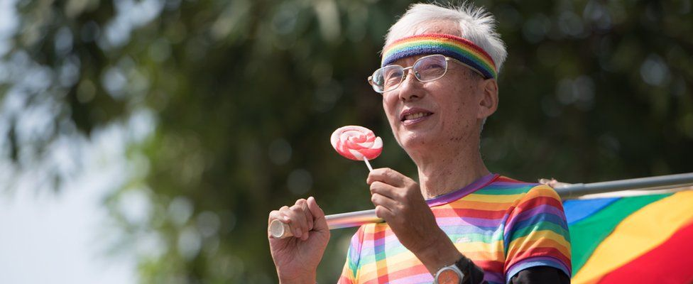 Taiwan gay rights activist Chi Chia-wei holds a rainbow flag during the 2018 Taipei Gay Pride March in Taipei,