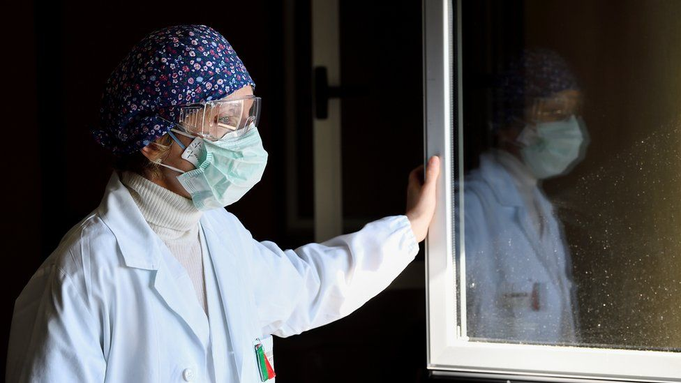 Laura Ricevuti, the medical doctor who diagnosed the first case of COVID-19 in an Italian patient with Dr. Malara on February 20, looks through the window at Codogno Hospital