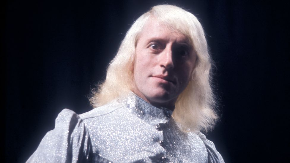 Jimmy Savile looking intently at the camera, sometime in the 1970s