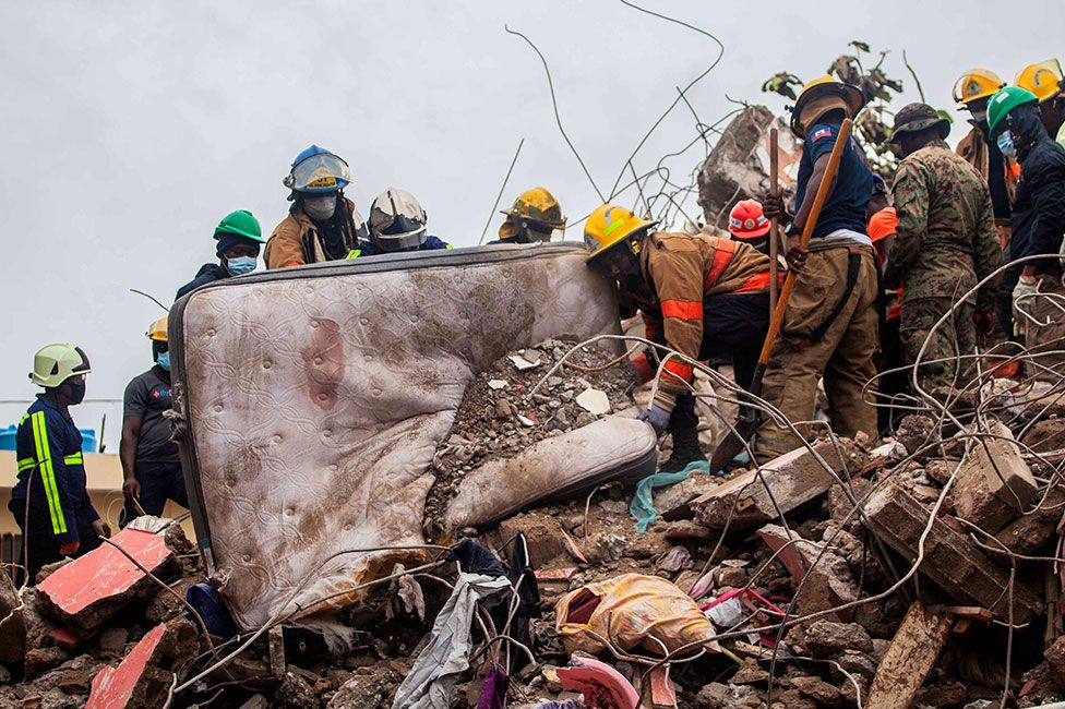 Firefighters remove debris in search of survivors in Les Cayes, Haiti on 17 August 2021