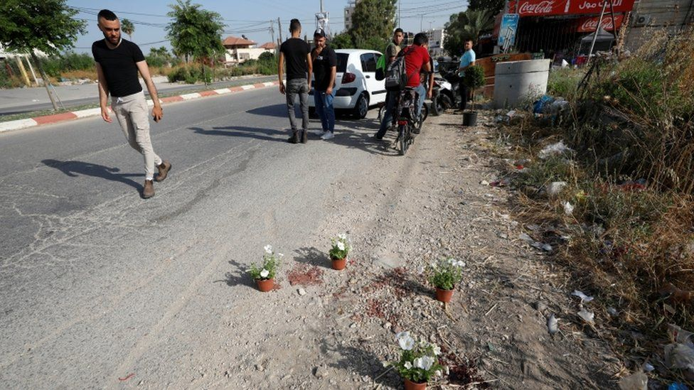 A man looks at the scene where Palestinian security officers were shot dead in Jenin