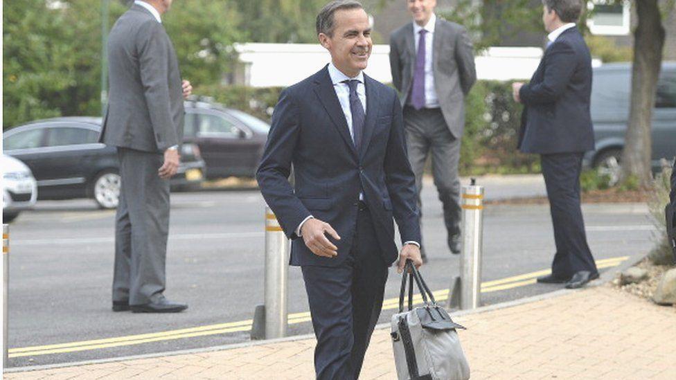 Mark Carney with bag