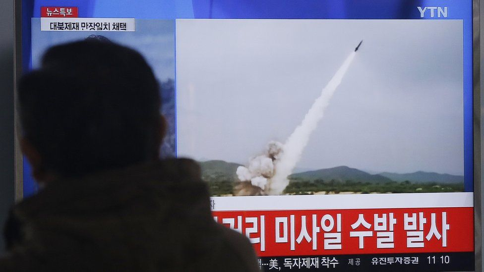 Man watches TV footage of missile launch conducted by North Korea, at Seoul Railway Station, South Korea, Thursday, March 3, 2016