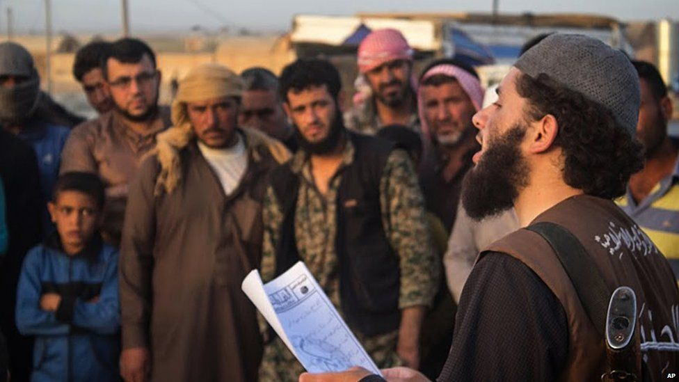 Islamic State militant reads verdict of Sharia court in Raqqa, Syria (14 May 2015)