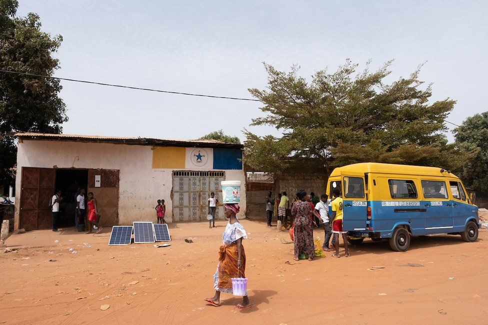 A small store outside the capital, Bissau, has a scale that local cashew producers can use to weigh their crop.