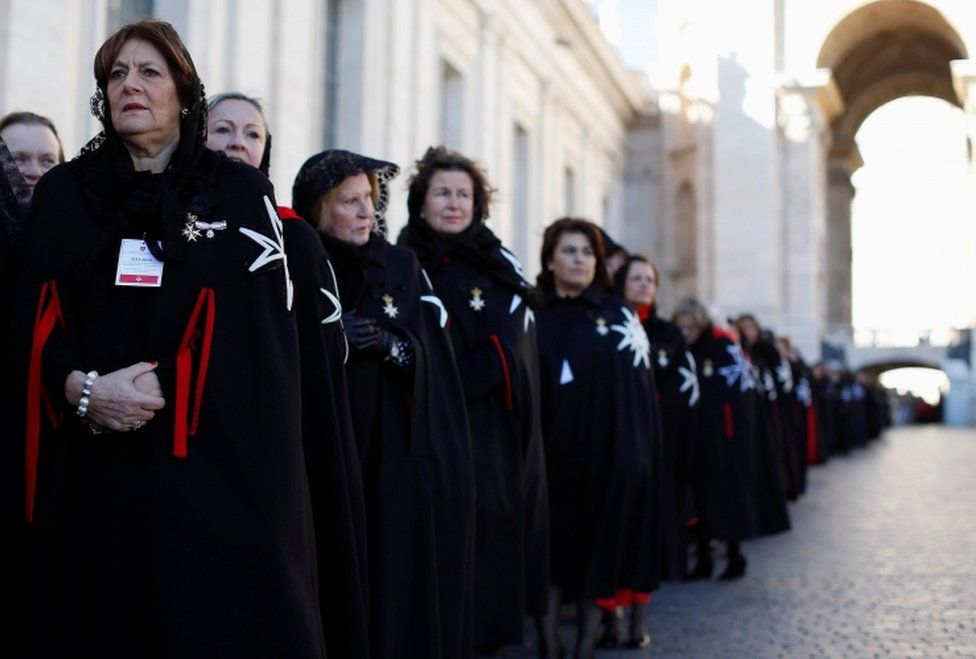 Members of the Order of the Knights of Malta arrive in St. Peter Basilica for their 900th anniversary at the Vatican February 9, 2013
