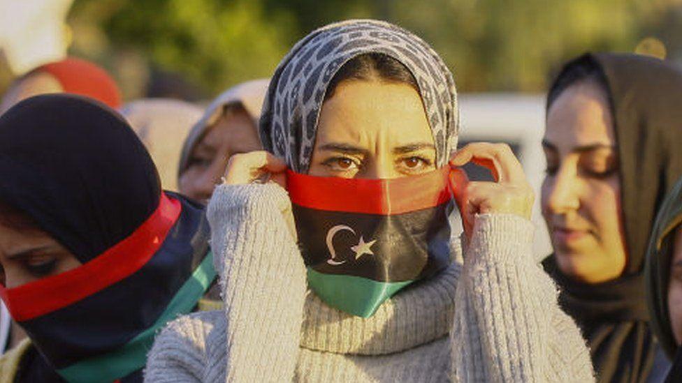 Demonstrators take part in a rally against eastern Libyan strongman Khalifa Haftar
