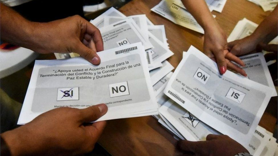 Electoral officials count votes at a polling station after a referendum on whether to ratify a historic peace accord to end Colombia's 52-year war between the state and the communist FARC rebels, in Cali, Colombia, on October 2, 2016