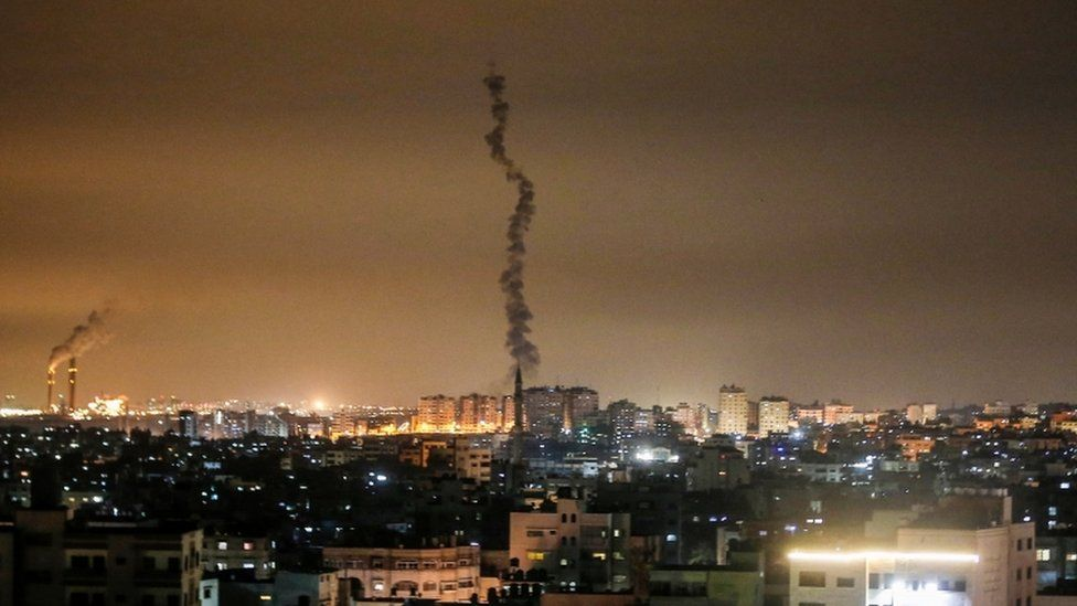 A picture shows the smoke trail of a rocket, fired by Palestinian militants, over the Gaza Strip