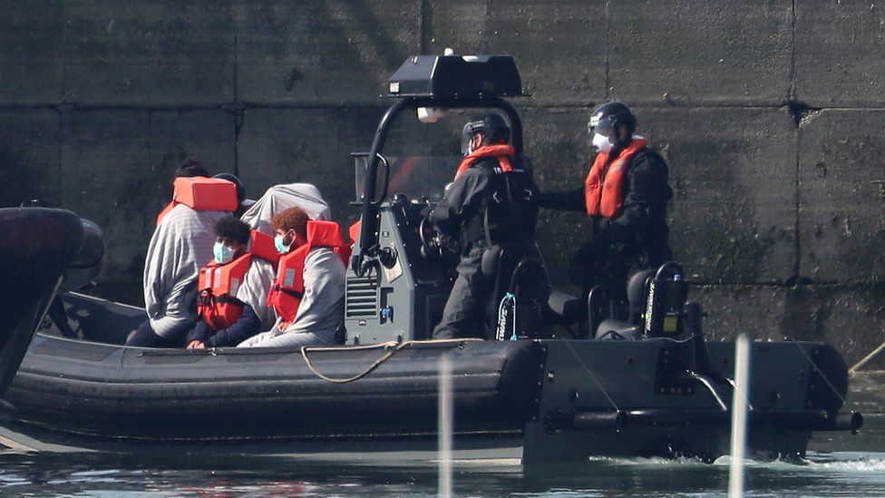Border Force officers bring to shore men thought to be migrants in Dover on Thursday 7 May
