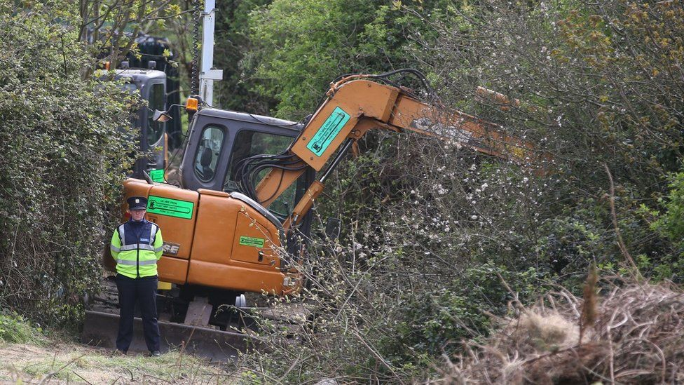 Police with digging equipment at the site where a human torso was found during a dig for the remains of convicted rapist James Nolan who vanished more than six years ago, at Tolka Valley Park, Finglas, Dublin