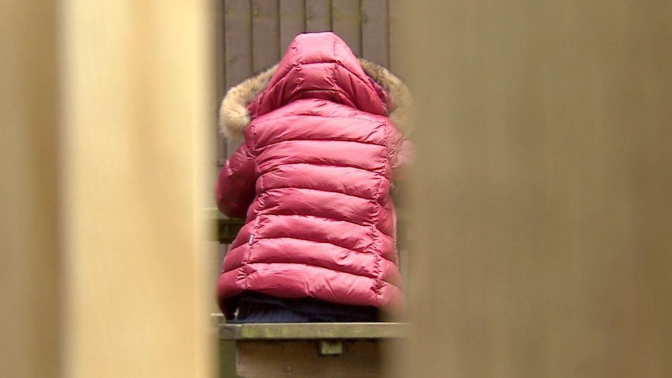 Rear shot 'Robyn' in pink coat