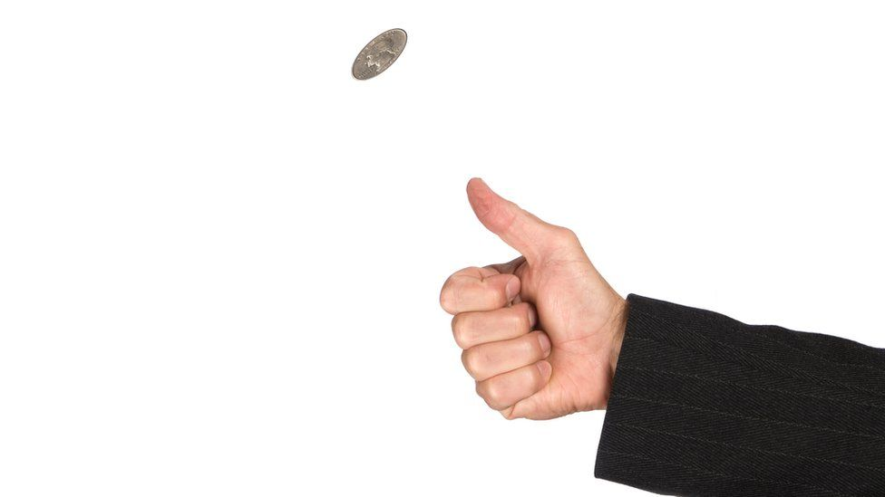 stock photo of a coin being flipped