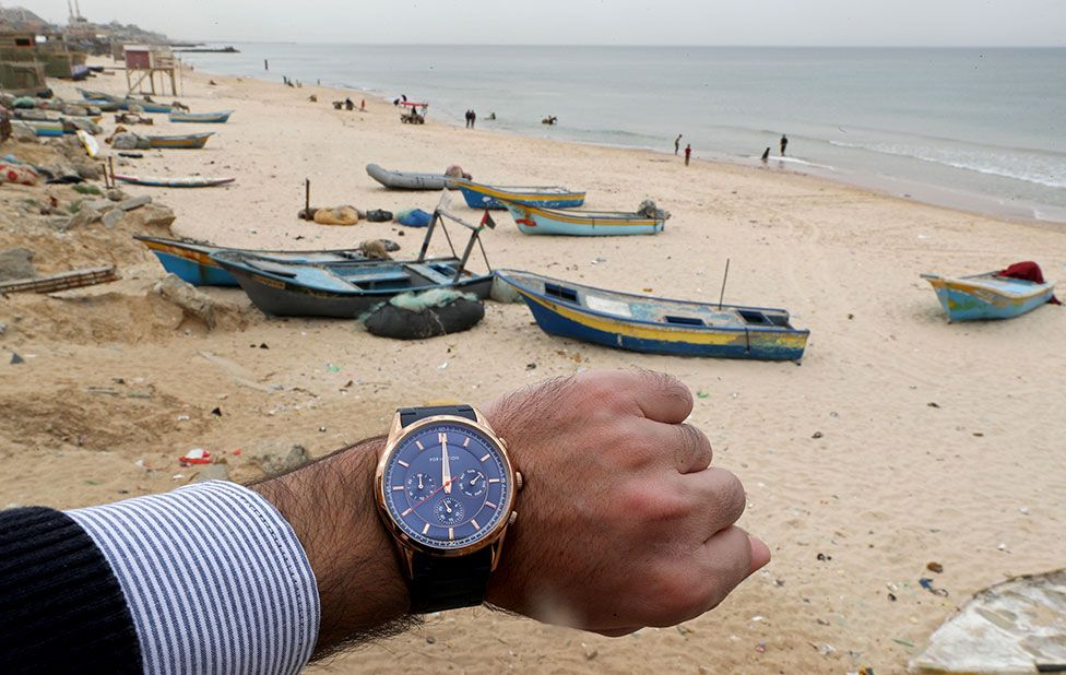 A watch showing the time at noon in front of a beach in the northern Gaza Strip, Palestinian Territories