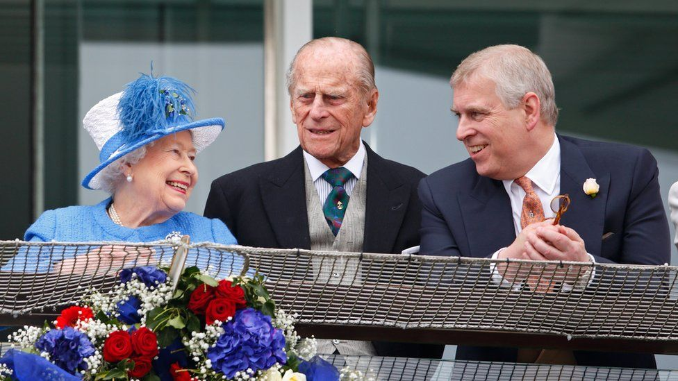 The Queen, the Duke of Edinburgh and Prince Andrew watch the racing from the balcony of the Royal Box as they attend Derby Day at Epsom Racecourse in 2016