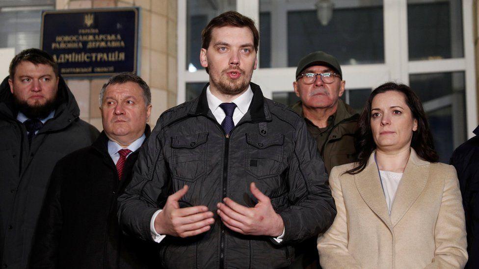 Prime Minister Oleksiy Honcharuk, (C) Interior Minister Arsen Avakov (second L) and Health Minister Zoryana Skaletska (R)