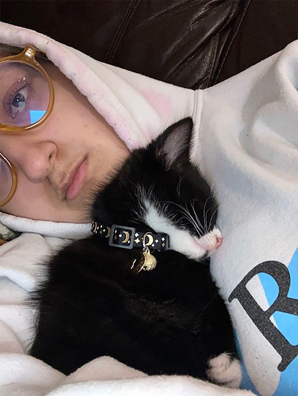 photo of Raisa holding kitten Chip