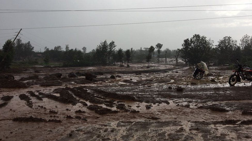 People roam in land devastated by the dam burst in Solai, Kenya on 10 May 2018