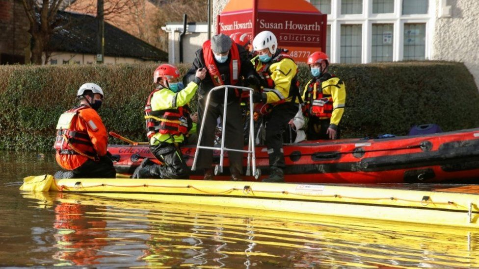 Rescuers helping a man