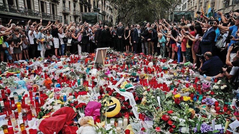 People light candles, leave flowers and notes for the victims who lost their lives in the terror attacks