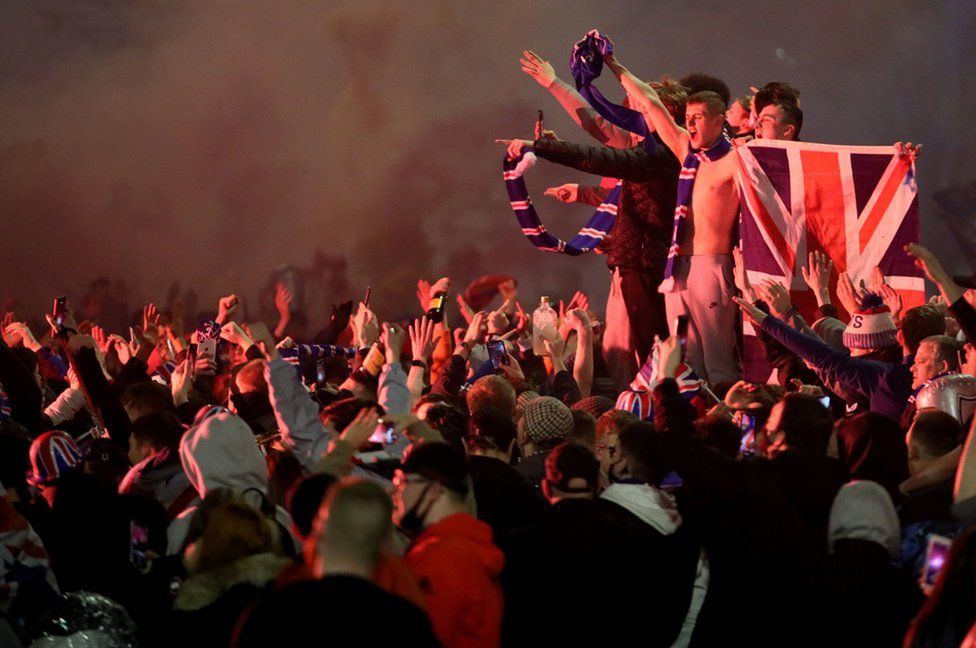Rangers fans celebrate in George Square, Glasgow after the club wins the Scottish Premiership title. 7 March 2021.