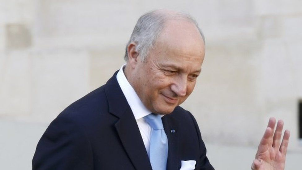 Laurent Fabius leaves the Elysee Palace following the weekly cabinet meeting in Paris, 10 February
