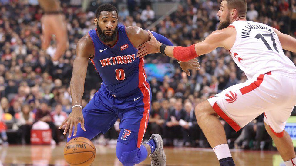 Andre Drummond of the Detroit Pistons drives against Jonas Valanciunas