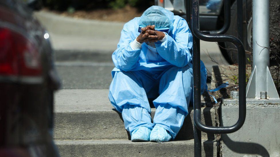 A tired healthcare worker is seen by the Brooklyn Hospital Center in New York, United States on April 1, 2020
