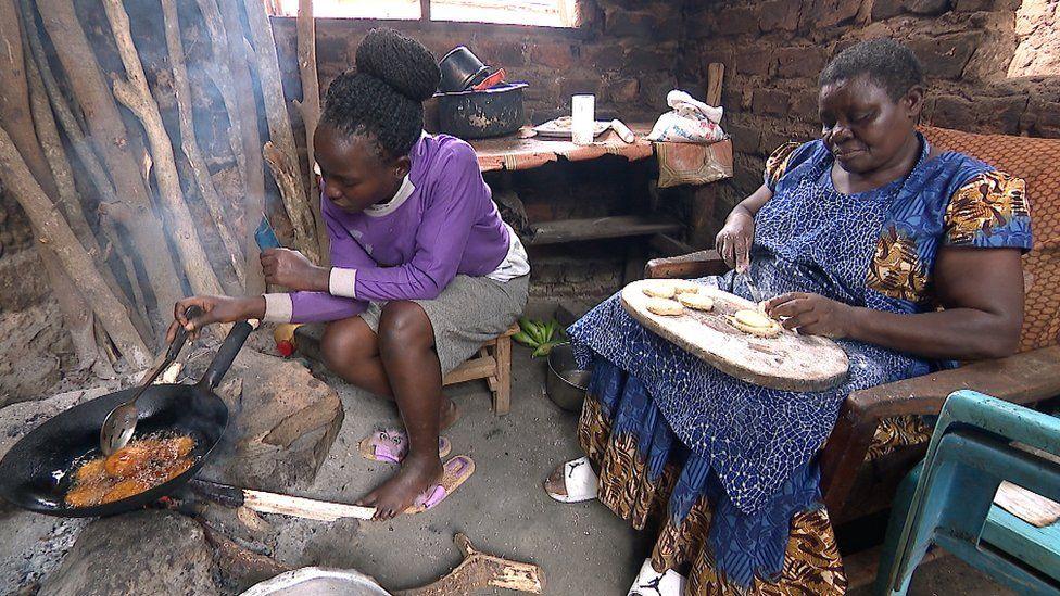 Joyce Namugalu Mutasiga making pancakes