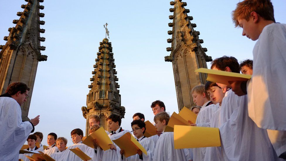 Magdalen College Choir singing on top of the tower