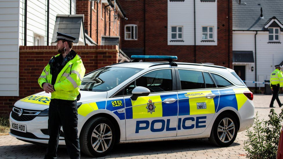 Police on the scene at Muggleton Road where a major incident was declared after a man and woman were exposed to the Novichok nerve agent