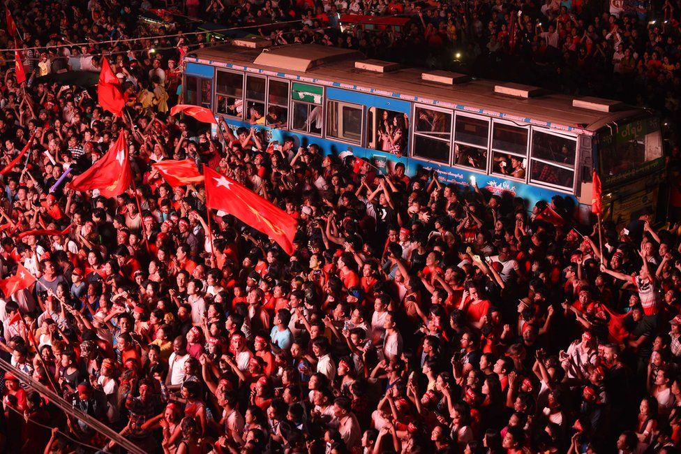 In this photograph taken late on 9 November 9, 2015, supporters of Aung San Suu Kyi's National League for Democracy (NLD) party gather outside the NLD headquarters in Yangon