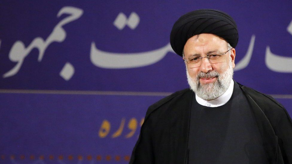 Ebrahim Raisi speaks to reporters after registering as a candidate for the Iranian presidential election (15 May 2021)