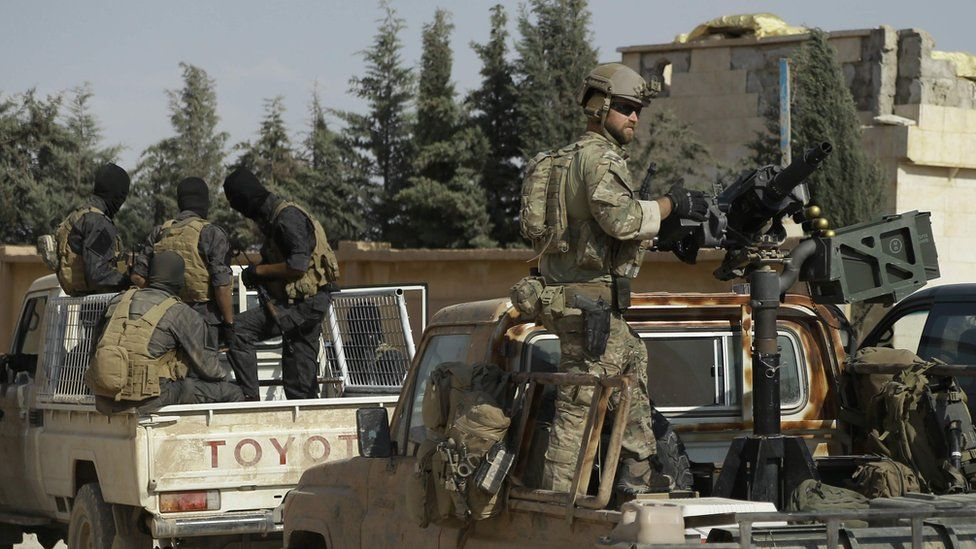 Armed men identified by Syrian Democratic forces as US special operations forces are seen in the northern Syrian province of Raqqa on May 25, 2016.