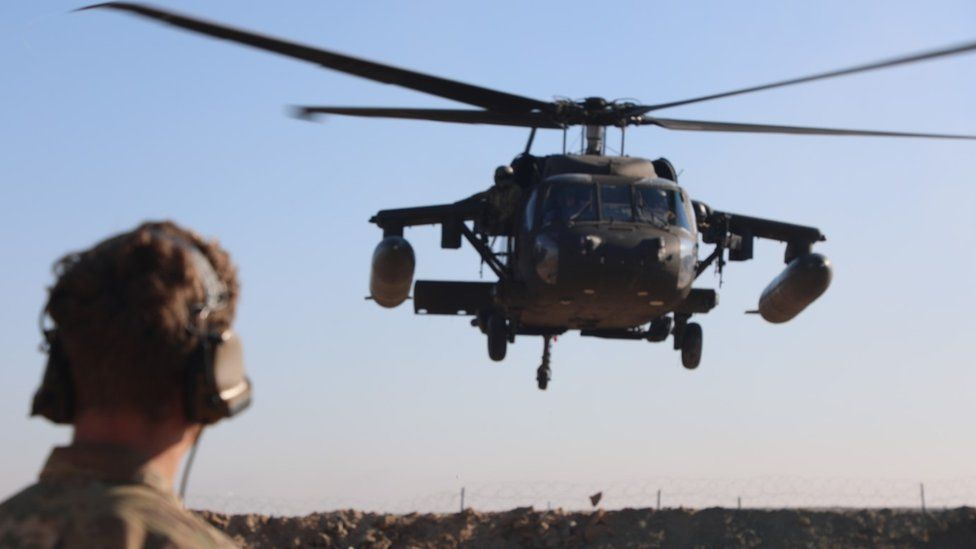 A U.S. Army Soldier assigned to the 3rd Calvary Regiment observes a UH-60 Blackhawk take off from an improvised landing zone during training at Firebase Sa-ham, Iraq, Dec. 9, 2018. The 3rd Cav. Regt. is deployed in support of Operation Inherent Resolve, working by, with, and through the Iraqi Security Forces and Coalition partners to defeat ISIS